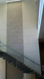 Beautiful glass staircase with cascade wall